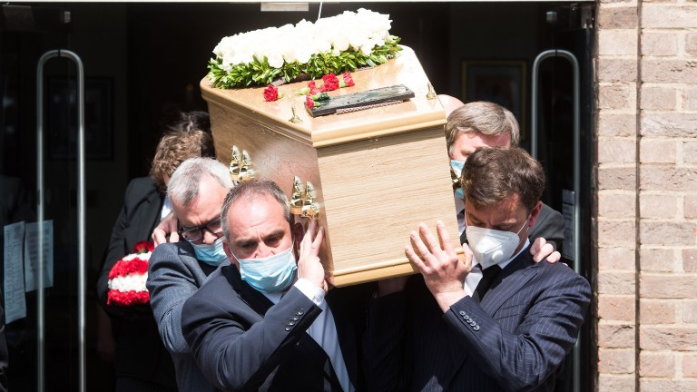 Barney Curley's coffin is carried out of the church on its way to the cemetery