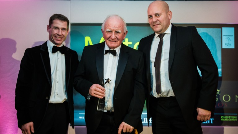 Milton Bradley is presented with a lifetime achievement award by former champion jockey Richard Johnson at the 2019 ROA Wales Horse Racing Awards