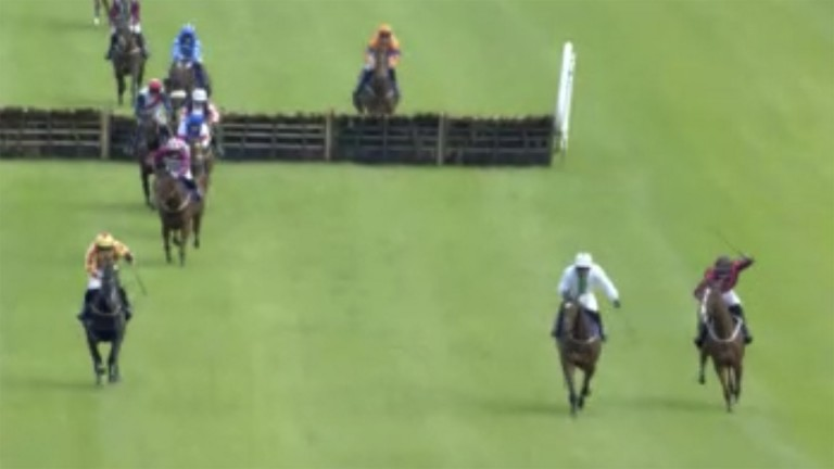 The 2-1 favourite Karakhan (second right) leads with Tommydan (right) for company