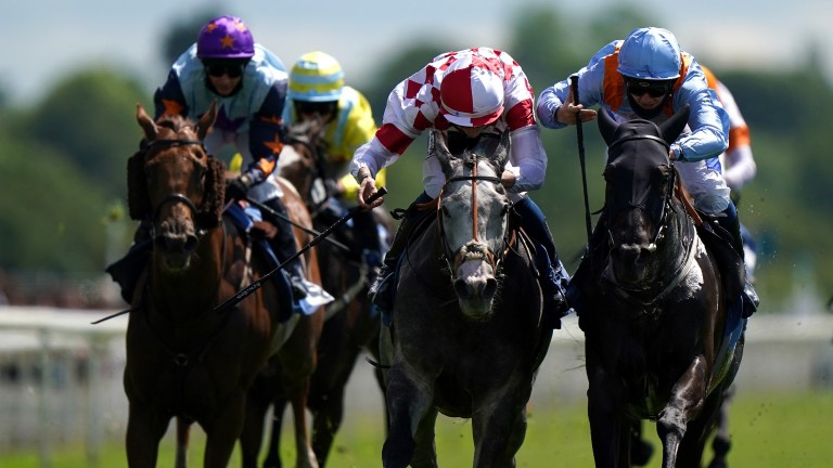 YORK, ENGLAND - JUNE 11: Civil Law ridden by jockey Ben Robinson (centre) wins the Churchill Tyres Handicap with Howzer Black ridden by jockey Shane Gray (right) second at York Racecourse on June 11, 2021 in York, England. (Photo by Tim Goode - Pool/Getty