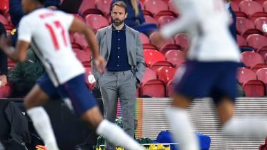 A beltless Gareth Southgate watches England defeat Austria