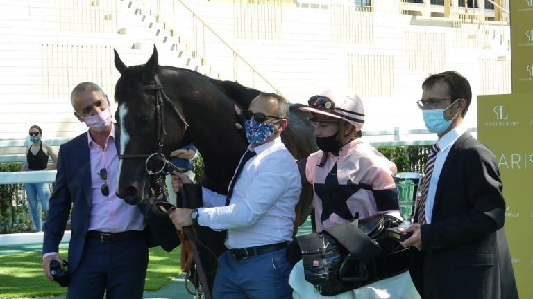 Iresine flanked by connections following his win in the La Coupe