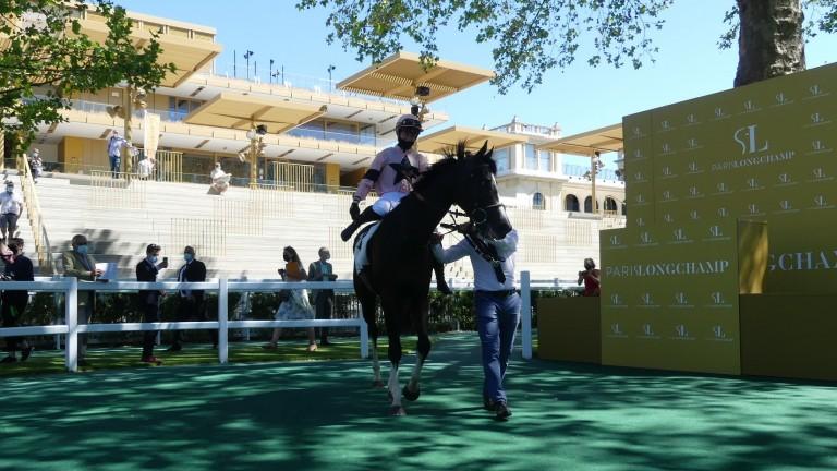 Marie Velon and Iresine return to the Longchamp winner's enclosure