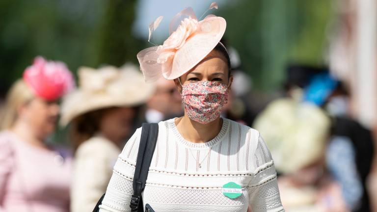 A racegoer arrives to Ascot for day one of the royal meeting