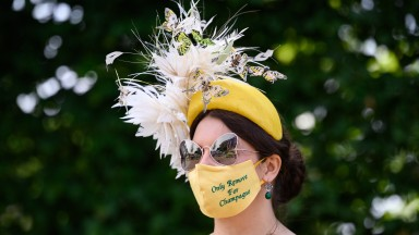ASCOT, ENGLAND - JUNE 15: Race-goer Anna Gilder poses for photographers as she enters the grounds at Ascot Racecourse on June 15, 2021 in Ascot, England. 12,000 spectators are being allowed to attend each day of the five-day meeting, with racegoers provid