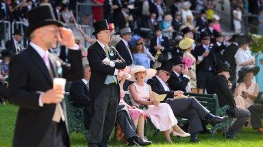 ASCOT, ENGLAND - JUNE 15: Race-goers gather ahead of the third race at Ascot Racecourse on June 15, 2021 in Ascot, England. 12,000 spectators are being allowed to attend each day of the five-day meeting, with racegoers providing negative Covid-19 tests to