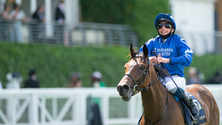 A beaming William Buick returns in front of the stands following Kemari's victory