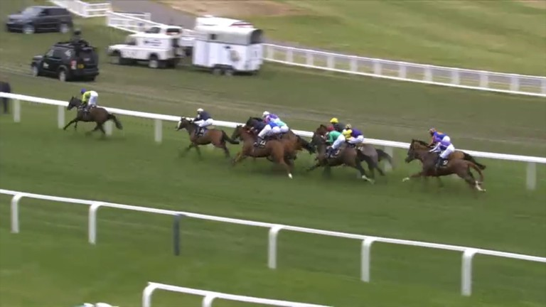 Subjectivist (green) is clear with Frankie Dettori (yellow cap) tucked on the rail