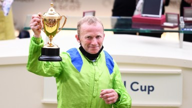 Jockey Joe Fanning poses with the Ascot Gold Cup