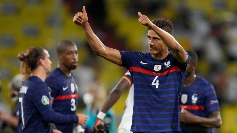 France defender Raphael Varane celebrates the win over Germany in Munich
