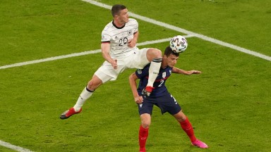 Benjamin Pavard was knocked unconscious after this clash with Robin Gosesns