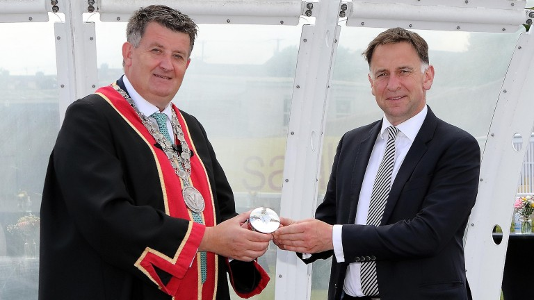 The master trainer is presented with a silver Freedom Box by Mayor Damien Geoghegan