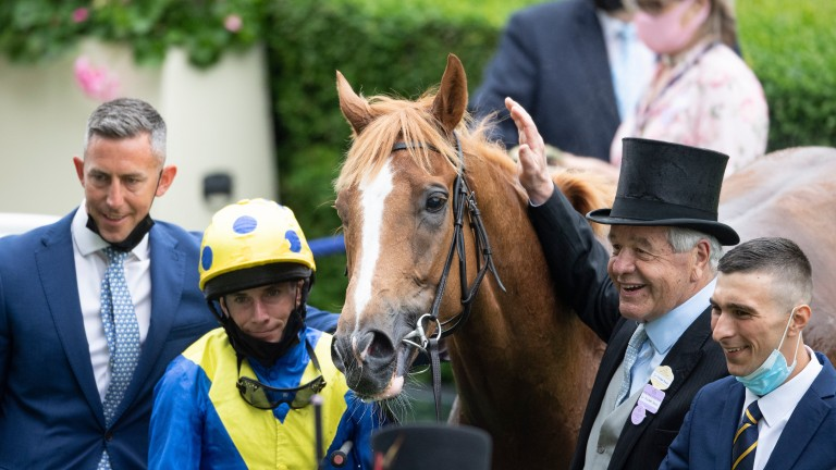 Sir Michael Stoute and Ryan Moore with Dream Of Dreams in the Ascot winner's enclosure