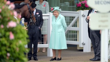 ASCOT, ENGLAND - JUNE 19: Queen Elizabeth II watches as horses are led into the parade ring during Royal Ascot 2021 at Ascot Racecourse on June 19, 2021 in Ascot, England. (Photo by Antony Jones/Getty Images for Royal Ascot)