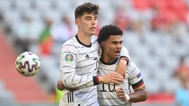 Kai Havertz and Serge Gnabry celebrate scoring Germany's third goal