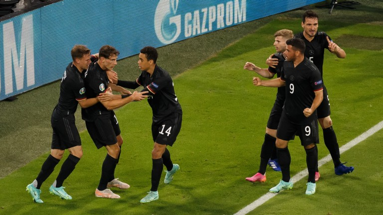 Germany celebrate their second equaliser against Hungary