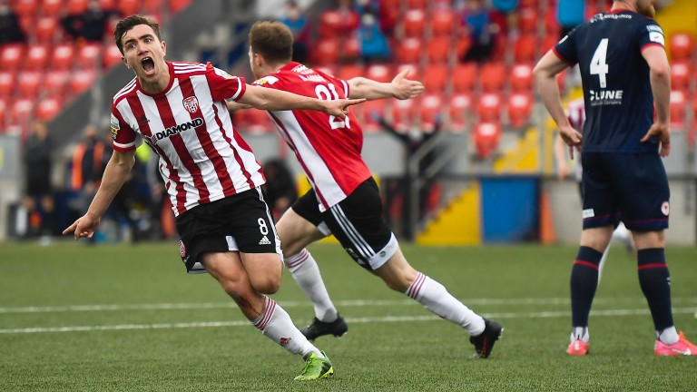 Derry City's Joe Thomson wheels away in celebration