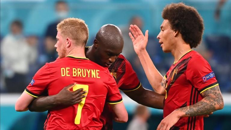 Romelu Lukaku forward of Belgium celebrates after scoring with Kevin De Bruyne  and Axel Witsel