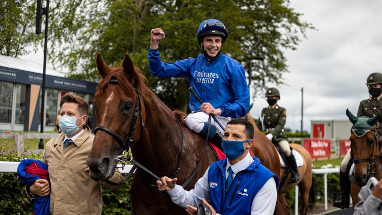 A delighted William Buick returns to the winner's enclosure at the Curragh aboard Hurricane Lane