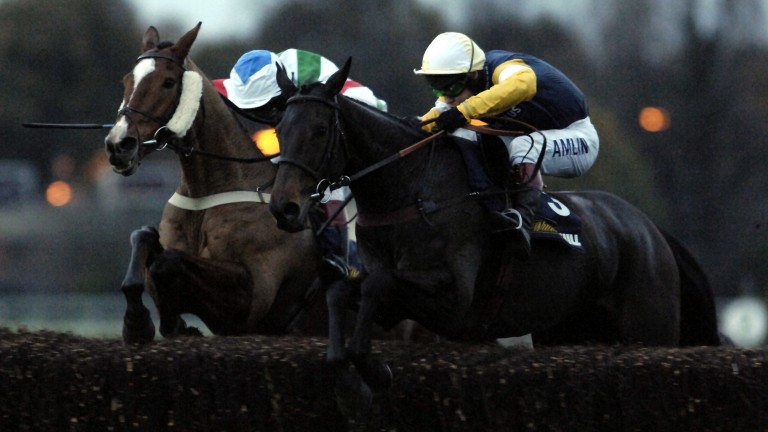 Willie John Daly (near side) and Richard Johnson jump the last with Brave Spirit and Mick Fitzgerald during an epic duel up the gruelling Sandown hill in the 2005 Marathon Chase