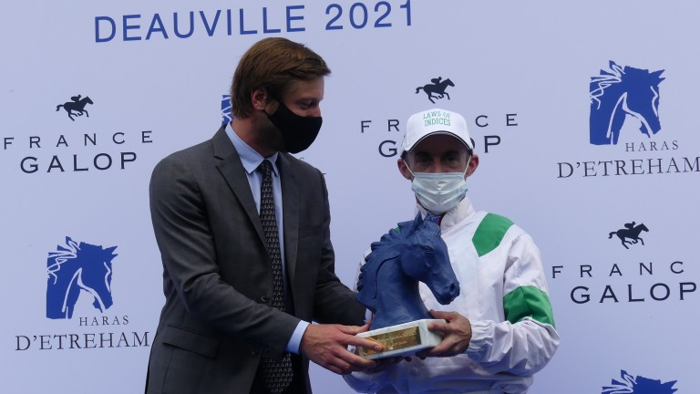 Olivier Peslier is presented with his prize after the Jean Prat