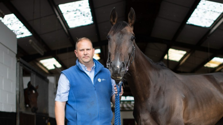 David Menuisier with stable star Wonderful Tonight: the trainer needs the weather to turn