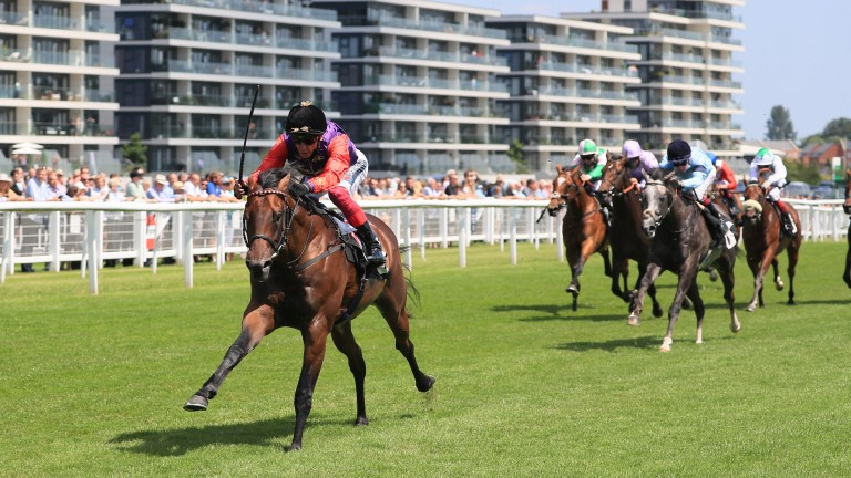 Reach For The Moon charges clear in the hands of Frankie Dettori