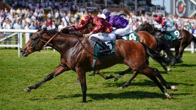 NEWBURY, ENGLAND - JULY 17: Sean Levey riding Gubbass (maroon) win The Weatherbys Super Sprint Stakes at Newbury Racecourse on July 17, 2021 in Newbury, England. Due to the Coronavirus pandemic, only owners along with a limited number of the paying public