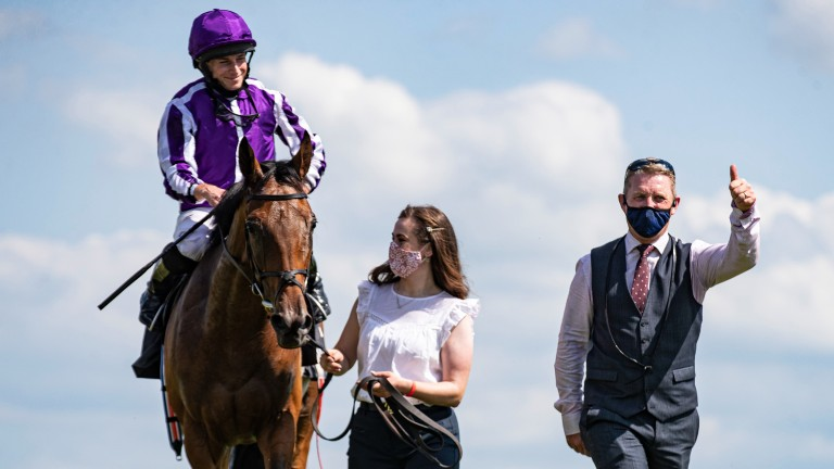Snowfall with Ryan Moore, Aimee Butler and Ballydoyle travelling head lad Pat Keating after winning the Juddmonte Irish Oaks at the Curragh