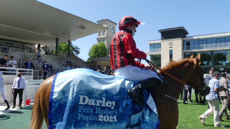 Atomic Force and Stephane Pasquier return to the Chantilly winner's enclosure after landing the Darley Prix Robert Papin