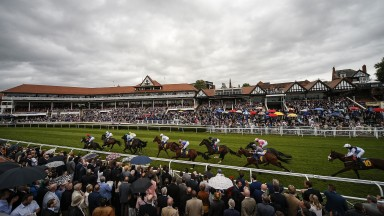 CHESTER, ENGLAND - MAY 09: A general view as runners pass the grandstands at Chester Racecourse on May 9, 2018 in Chester, United Kingdom. (Photo by Alan Crowhurst/Getty Images)