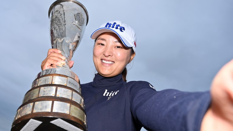 Jin Young Ko poses with the Evian Championship trophy