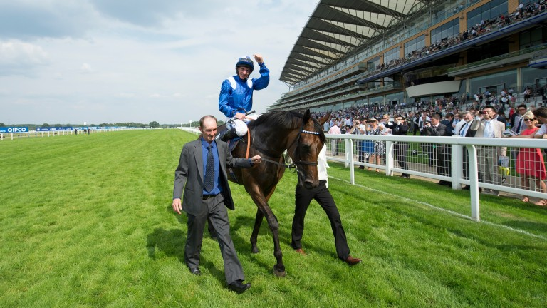 Paul Hanagan celebrates after Taghrooda's King George VI and Queen Elizabeth Stakes victory in 2014