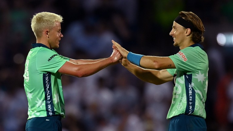 Sam (left) and Tom Curran celebrate Oval Invincibles' opening win