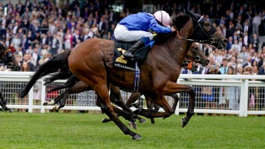 ASCOT, ENGLAND - JULY 24: William Buick riding Danyah (R, blue/pink cap) win The Moet & Chandon International Stakes at Ascot Racecourse on July 24, 2021 in Ascot, England. (Photo by Alan Crowhurst/Getty Images)