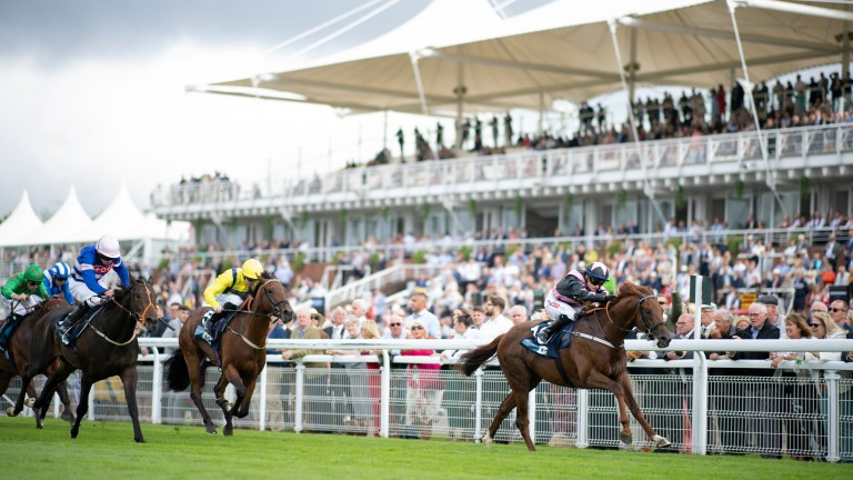 Sisters In The Sky (right) wins the 6f maiden