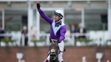 Oisin Murphy salutes the crowds after winning the Sussex Stakes