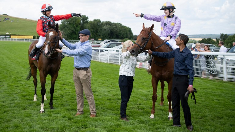 Thea Gosden Hood (right) and Candida Crawford celebrate dead-heating in the Magnolia Cup