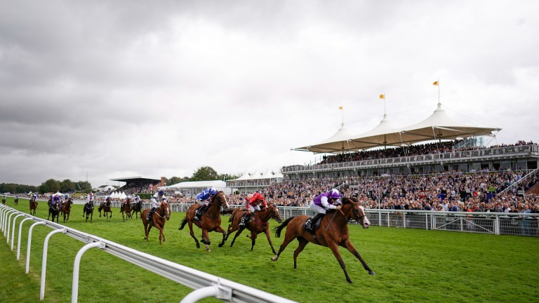 CHICHESTER, ENGLAND - JULY 30: Pat Dobbs riding Calling The Wind win The Unibet 3 Boosts A Day Goodwood Handicap during the Qatar Goodwood Festival at Goodwood Racecourse on July 30, 2021 in Chichester, England. (Photo by Alan Crowhurst/Getty Images)