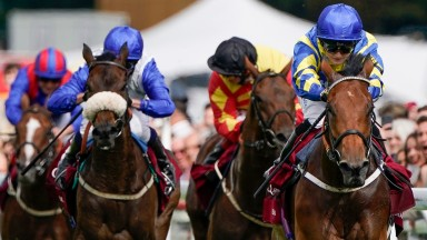 CHICHESTER, ENGLAND - JULY 27: Hollie Doyle riding Trueshan (R, blue/yellow) win The Al Shaqab Goodwood Cup Stakes during the Qatar Goodwood Festival at Goodwood Racecourse on July 27, 2021 in Chichester, England. (Photo by Alan Crowhurst/Getty Images)