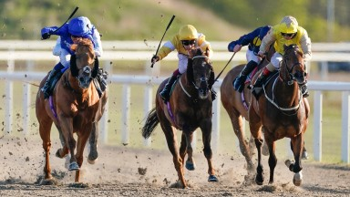 CHELMSFORD, ENGLAND - APRIL 22: Jim Crowley riding Raaeb (L, blue) win The chelmsfordcityracecourse.com Handicap at Chelmsford City Racecourse on April 22, 2021 in Chelmsford, England. Sporting venues around the UK remain under restrictions due to the Cor