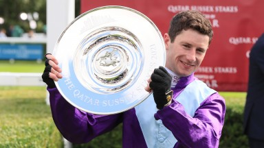 Big winner: Oisin Murphy with the trophy after the Andrew Balding-trained Alcohol Free's victory in the Group 1 Sussex Stakes at Goodwood