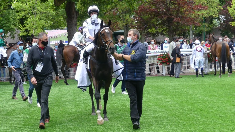 Oscula and Ryan Moore return to the Deauville winner's enclosure after the Prix Six Perfections Sky Sports Racing