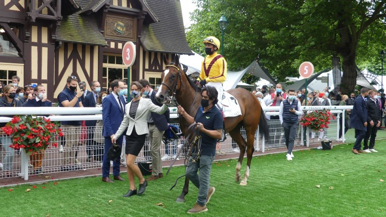 The gleam team: Frankie Dettori and Twilight Gleaming are led in after victory in the Listed Prix de la Vallee d'Auge
