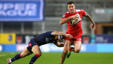 Shaun Kenny-Dowall of Hull KR tries to skip away from a tackler