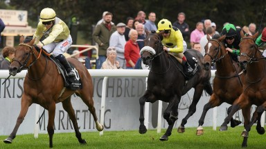 Hollie Doyle and Romantic Time charge home in the Dick Poole