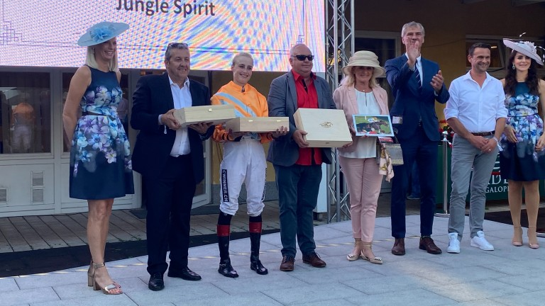 Sibylle Vogt receives her prize with winning connections at Baden-Baden
