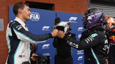 George Russell (left) and Lewis Hamilton will be teammates at Mercedes next year
