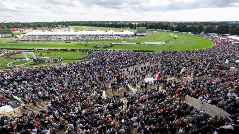 Racegoers at a packed Doncaster watch Hurricane Ivor land the Portland on Saturday