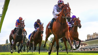 Teona and Olivier Peslier stride clear of Snowfall (far right) and La Joconde (striped cap) in the G1 Qatar Prix Vermeille